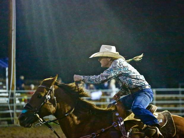 Aspen cowgirl Taylor van Zyl competes in the barrel racing event on Wednesday, Aug. 7, 2019, at the Snowmass Rodeo.