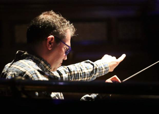 Andy Einhorn photographed conducting rehearsals for