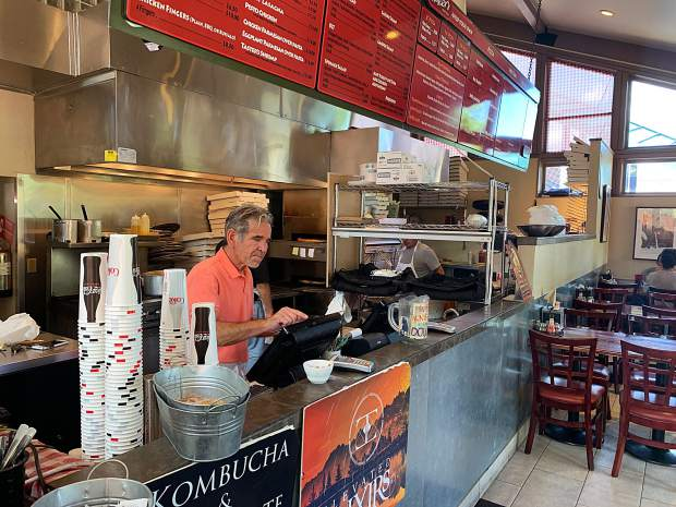 Taster's Pizza employee David Lucero rings up an order Wednesday at the restaurant, which will have its last day of business in Aspen on Aug. 31. It has been at the Aspen location since March 2008.