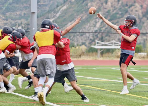Aspen High School junior quarterback Tyler Ward throws a pass during practice on Wednesday, Sept. 4, 2019, on the AHS turf. (Photo by Austin Colbert/The Aspen Times)
