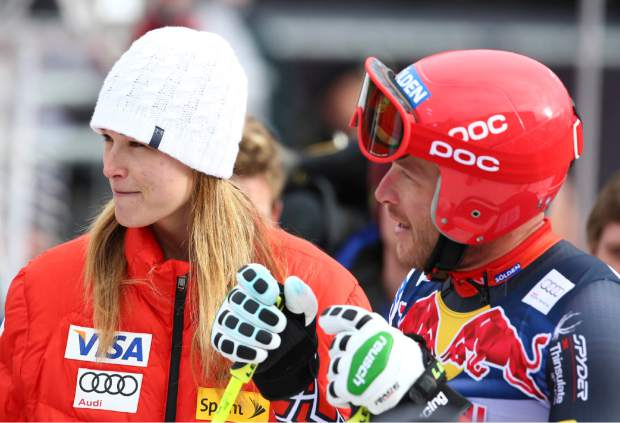 FILE - In this Jan. 23, 2014, file photo, Bode Miller talks to his wife, Morgan, in the finish area of men's skiing World Cup downhill training in Kitzbuehel, Austria. Miller is moving his family to Montana part time after a tumultuous year that included the tragic drowning of his toddler daughter. Miller says 19-month-old Emeline Miller's death made him sharpen his focus on his four other children, and with twins due this fall, he decided the time was right to head to the mountains. The family will split their time between homes in Southern California and Big Sky, Mont. (AP Photo/Giovanni Auletta, File)