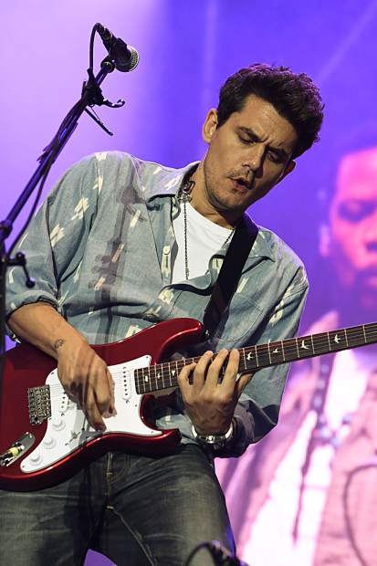 John Mayer play the guitar at the JAS Labor Day Experience in Snowmass Village on Saturday, Aug. 31.