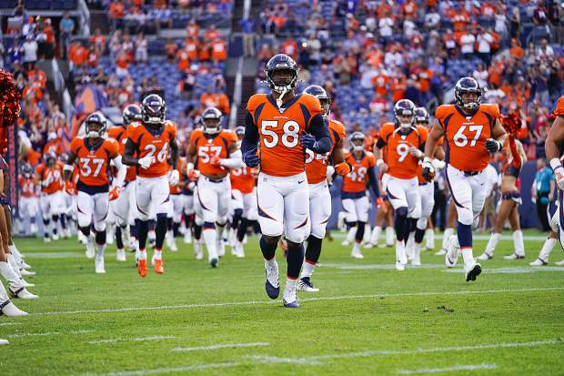 Outside linebacker Von Miller and the 2019 Denver Broncos take the field during an NFL preseason game on Aug. 19.