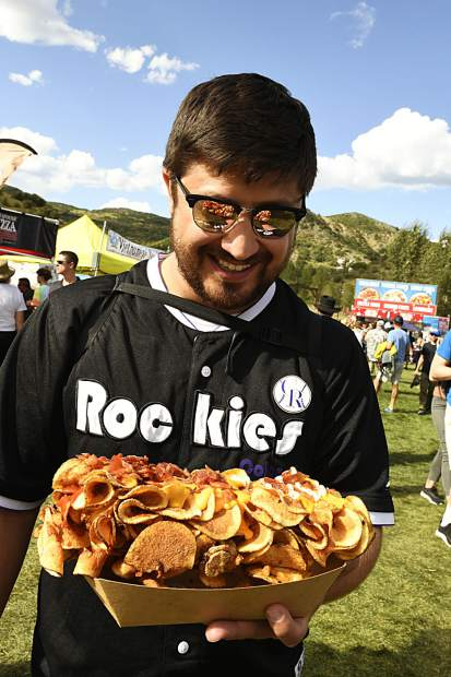 A Denver man holds a plate of fried food at JAS Labor Day in Snowmass.