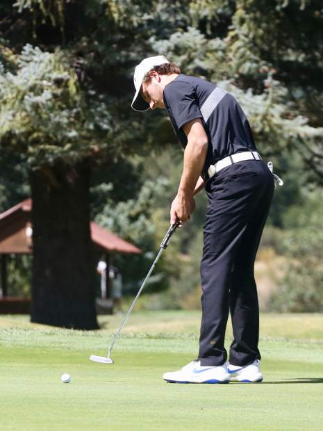 Aspen High senior Jack Pevny putts during the Skiers' home tournament earlier this season.
